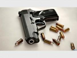 Gun-With-Bullet_666125685