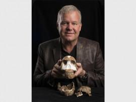Professor Lee Berger with the skull of Homo naledi. Photo: Wits University