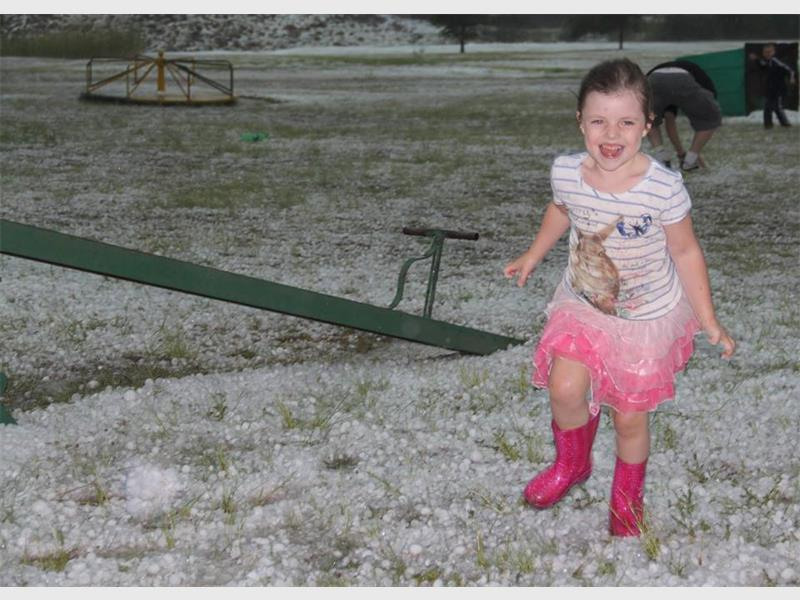 Chloe Shannon (5) played in the snow-like hail shortly after the storm ended. Photo: Carla Shannon.