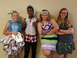 Curro pupils model their recyclable fashion.