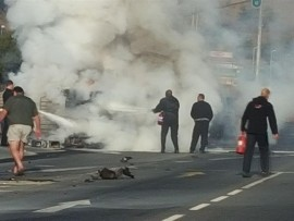 People first on the scene start to extinguish the burning taxi. Photos courtesy of the eyewitness.
