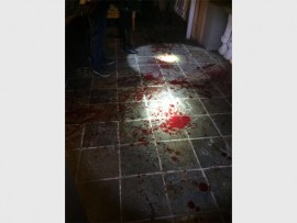 Blood everywhere after a man was stabbed several times at his own front gate last night.