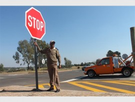 Mogale City Traffic Department's Papi Motaung at the N14/Ranfontein/Ventersdorp intersection where large stop signs were put up following the horrific accident which claimed two lives last month.