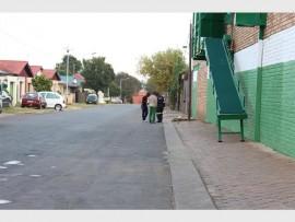 Police investigate the scene in Potchefstroom Street, Burgershoop.