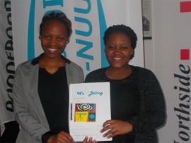 Nomshado Skhosana and Lethlogonolo Mafatlha hold a mock copy of their magazine, You Belong.