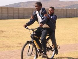 Tshepo Masekela enjoys the company of Tsholetsang Letlhogonolo on his new bicycle.