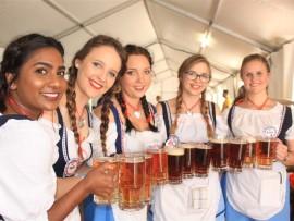 Kim Gounden, Monica Hogg, Tamra Golob, Anushka Kemp, Micheala Wanten, and Kirsten Talbot, waitresses at this years' bierfest holds an array of colourful bier.