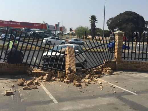Lucinda Koekemoer at the spot where the vehicle came through the wall on Sunday. She says employees park the vehicles there and regularly stand at the exact spot during breaks. (Photo: Riaan van Zyl)