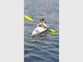 Young Atle Maphanga enjoys her canoeing training at Florida Lake. Photo: Supplied