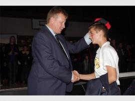 Hoërskool Bastion's principal Gerhard Koekemoer capping Brandon Olivier. Photo: Sonwabile Antonie