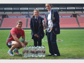 Xerox Golden Lions player Ruan Dreyer  with Hoërskool Bastion pupils at Emirates Airline Park. Photo: Supplied