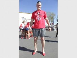 Former Springbok rugby player, Warren Bosnihan in his red high heels. Photos: Sonwabile Antonie