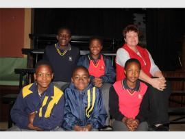 Back: Ntombi Sibambo, Olebogeng Oliphant and their choirmaster, Esmè Axsel. Front: Sihle Mahlangu, Kelebogile Mathibela and Nthateng Manca. Photo: Sonwabile Antonie