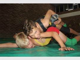 Christopher Schaper pins his fellow-wrestler Esterhuizen. Photo: Sonwabile Antonie