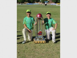 Two of Florida Cricket Club's U/13 players posing with the trophy they took home. Photo: Supplied