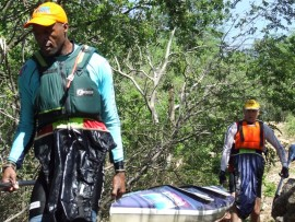 Shaun Maphanga and partner Neil Butcher portaging over the Goosebay Canyon weir which was too dangerous to shoot . They finished third in the Sub-veteran age group at the Vaal Marathon, which was the SA K2 River Championships race (Doubles event).