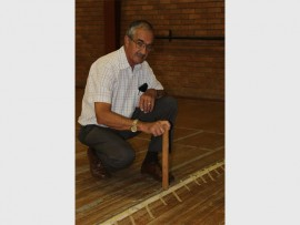 Chris Potgieter is concerned about the uneven flooring caused by water damage.