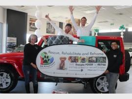 Lynne Lovell from Ark Animal Center poses with Jason Jones, Basil Clenzos and Zelda Monametsi from Jeep.