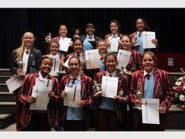 Pupils from Holy Rosary High School recently received trophies for hockey at the end of term assembly. The 13 pupils can be seen holding their certificates and trophies. At the back are Gabriella Martin, Patricia Zongololo, Brittney Moore and Oshai Naidoo. In the middle are Jane Taylor, Daniela Patrizi, Kelly Marcel, Julia Deverell and Caitlin Norrie. In front are Bontleng Dibakwane, Nicole Pataco, Sarah Kwan and Caitlin Barlow.