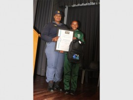 Sergeant Sharon Mahamba-Tsotsotso handed a prize to Simphiwe Ndou as part of the Take a Girl Child to Work initiative.