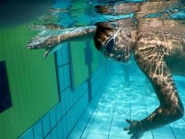 Swimmer, Nicholas Smith, in an underwater action shot.
