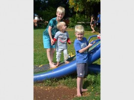 Samuel, Piper and Joel Gernetzky playing on the jungle gym at Gillooly's Farm