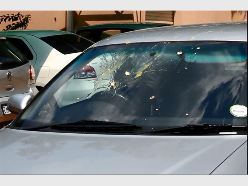 Egged... The egg splatter on a car windshield.