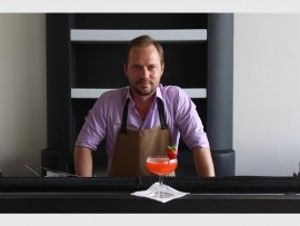 REFRESHING: Raymond Endean, head trainer at Thirst Bar Services, makes a traditional strawberry daiquiri.