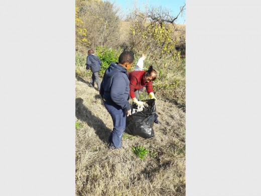 HELPING HAND: Unity College pupil Kibogo Kinyua and head of department, Estelle Henderson pick up litter.