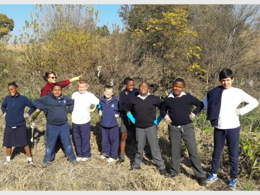 THUMBS UP: Pupils of Unity College help clean up the Jukskei River.