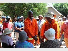 Ward 114 councillor, Victor Mafinya and Mayor Herman Mashaba converse with residents in Zandspruit.