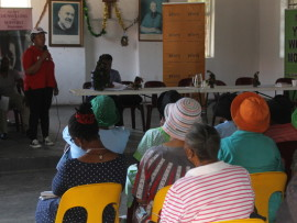 Jacqui Chauke of NPO Agisanang Domestic Abuse Prevention and Training addresses a workshop for elderly Alex residents.