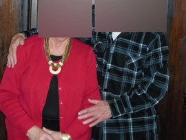 The complainant (in red) is pictured wearing some of the jewellery items which she alleges were stolen by her husband's carer.
