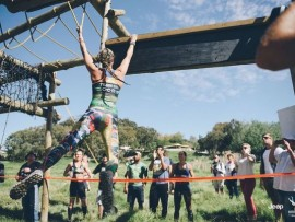 Sabrina Daolio completes part of an obstacle course that involves swinging from ropes using only the strength in her arms. Photo credit: Hayden Brown.