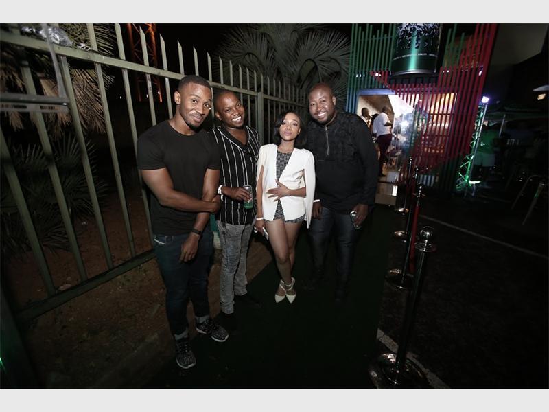 Photo: Supplied  CELEB HANGOUT: Lunga Shabalala, Zola Hashatsi, Thando Thabethe and Bujy celebrate the opening of the Heineken Next Level Bar on Smit Service Street in Braamfontein.