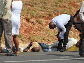 Law enforcement agents investigate the scene of a shooting on the N12 West, Boksburg, on Tuesday.