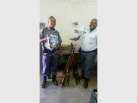 Seen with the confiscated weapons are Const Thabo Hlatshwayo (left) and Const Sibusiso Malinga.