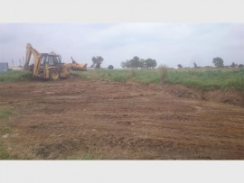 A  tractor can be seen filling the trench that had been left open since October, last year.