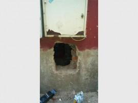 Thieves cut through the wall to gain access to Liquor City.