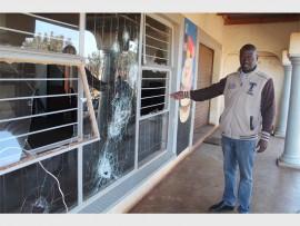 Jeremiah Madumo Khoza next to his house where they broke the windows.