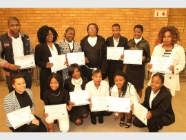 Seen with their teacher, Carmen Barnes, are students who successfully completed the End User Computing course.
