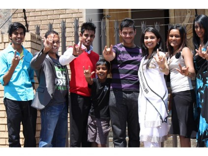 Miss India South Africa 2013, Gabriella Seekola, with some of the youth of the Actonville Full Gospel church.