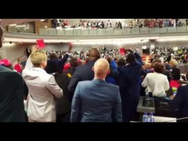 DA members take out red cards while EMPD removes the EFF