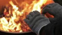 stock-footage-homeless-man-warming-his-hands-by-a-fire
