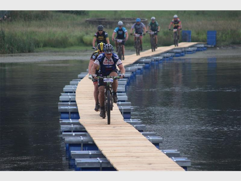 Cyclists take on the floating bridge at last year's Transvaal Galvanisers Mountain Bike Race.