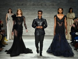 Designer David Tlale walks the runway with models at the David Tlale fashion show during Mercedes-Benz Fashion Week Fall 2014 at The Pavilion at Lincoln Center on February 9, 2014 in New York City.  (Photo by Frazer Harrison/Getty Images for Mercedes-Benz Fashion Week)