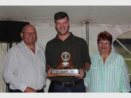 Francois Robbertse receives Brakpan Rugby Club's Senior Sportsman of the Year Award from Harry Nieuwenhuis (club chairman, left) and Saartjie Vermeulen (club secretary, right).