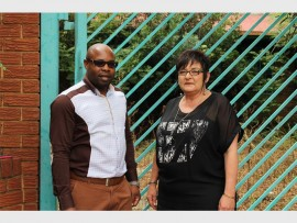 Khume Ramulifho and Veronica Dyson, in front of the gate of the old Brakpan Primary School.