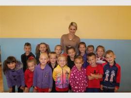 Presenter Karen Ferreira with children from Ons Kuierplekkie. The nursery school will feature on the children's programme, Kleuterzone.