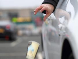 motorist-dropping-litter-from-a-car